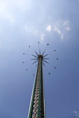 adrenaline rush: A carousel taking people very high up in the air