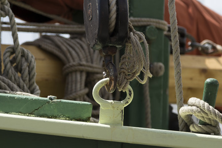 the close range: a boat detail with rope and equipment from a close range Stock Photo
