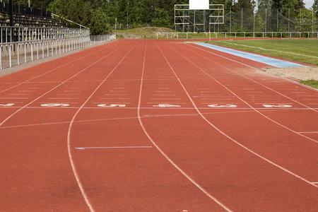 suspenso: La curva de una pista de corredores
