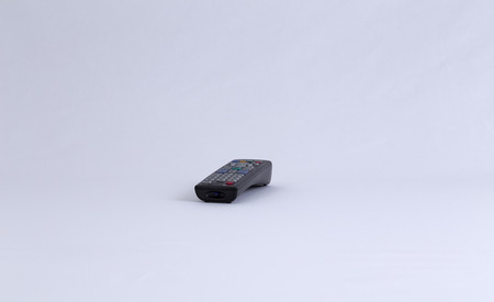 manipulate: An isolated TV remote control facing direction towards you. Stock Photo