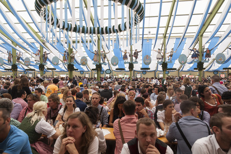 ludwig: Munich - Germany September 20, 2014: A beer tent with a lot of customers waiting to be served beer and food and listening to music.  Oktober fest starts in September and the reason for that goes way back. 1810 Crown Prince Ludwig marred Princes Therese Vo Editorial