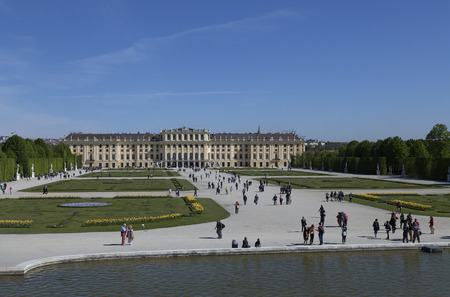 nbrunn: All the flower arrangements and persons walking around in the park area in Schnbrunn