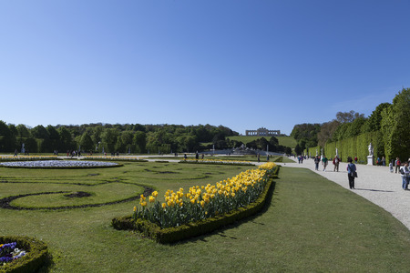 nbrunn: Vienna - Austria April 18, 2014:  Flowers and persons walking around in the park area in Schnbrunn