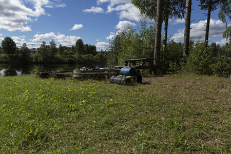 sweden resting: camping and fishing equipment in a park area Stock Photo