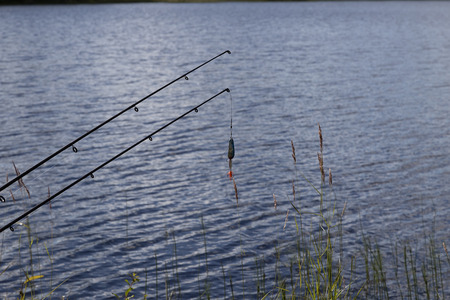 sweden resting: A lure and two rods in front of the water
