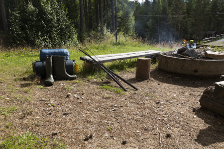 fishing equipment: Camping, fishing equipment, a fire place and two rods