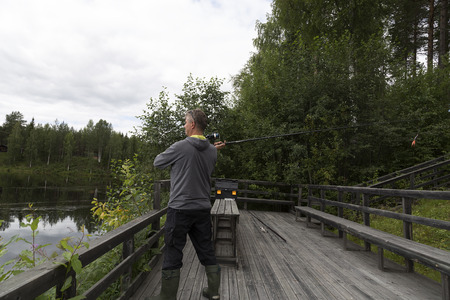 sweden resting: Fishing in the river Stock Photo