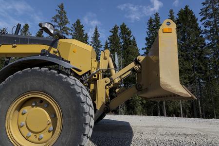 grader: A closer look at at grader and its plow.