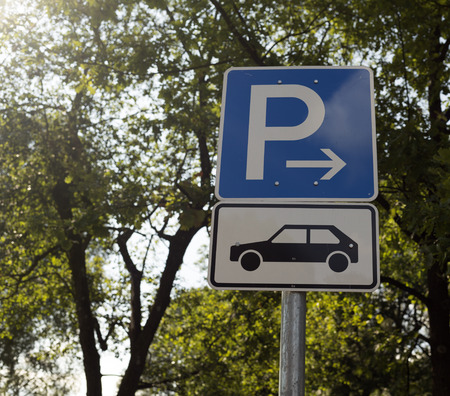 explanations: A sign on a pole showing where one can park the car Stock Photo