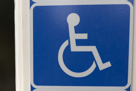 enlighten: A sign for handicap showing that there is special rights and ways to transport your self if you are handicapped Stock Photo