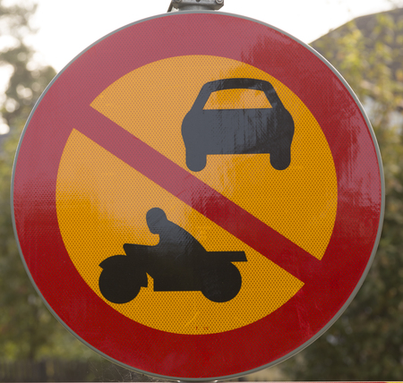 enlighten: A sign showing that its forbidden for all vehicles with engines Stock Photo