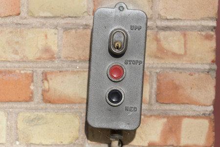 electronical: A electronical switch mounted on a brick wall Stock Photo