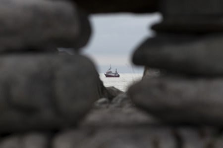 sighted: A ship on the ocean sighted between some stones