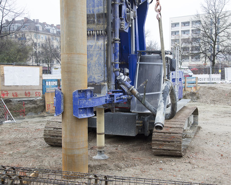 hydraulics: A closer look at a crane and a coil for a foundation for a building
