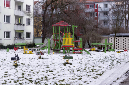 grass area: A winter playground with a snow covered grass area