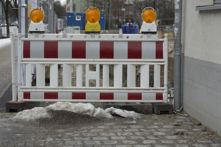 wicket gate: A group of warning lights in front of a construction site