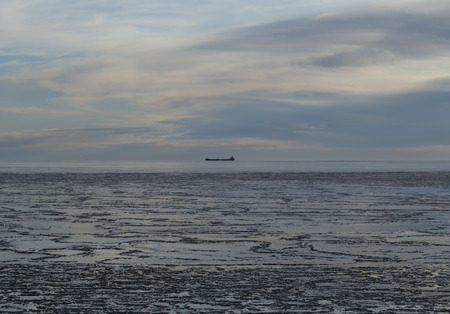 horizontals: A cargo ship in the horizon