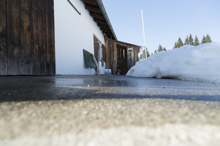concrete form: A low angle photo on a concrete plat form in front of the storage area and some melting snow