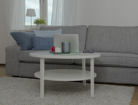 cosily: A living room scene with a computer and a sofa Stock Photo