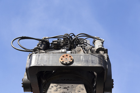 hydraulics: A piece of hydraulics with a blue sky in the background Stock Photo