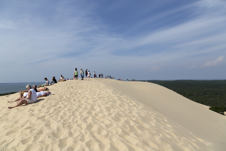 top 7: Dune du Pilat, France - June 7, 2016: Resting at the Dune du Pilat The biggest target for tourism in France, the big dunes at Dune du Pilat, people are climbing up to the top of this sand mountain which is created from sand blowing from the ocean. Many pe Editorial