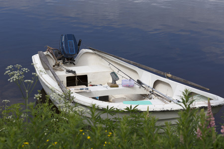 fishing gear: A small fishing boat with some fishing gear in it on a river Stock Photo