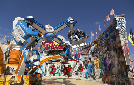 Some girls having fun in a ride during october fest in Munchen