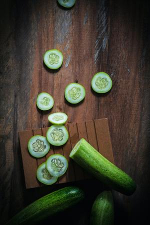 cucumber: Cucumber illustration background wooden floors.