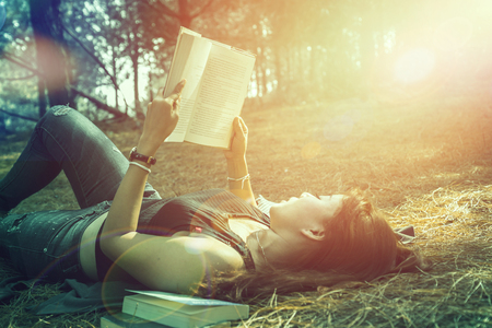 Woman relaxing reading in park. holiday
