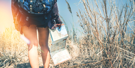 Female legs walking. Female travelers travel nature mountain map navigation