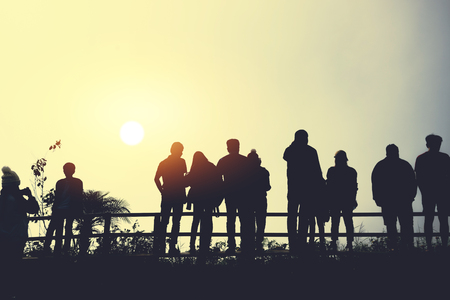 asians travel relax in the holiday.People stand looking at the sun in the morning. Stand up for sunrise on the Moutain