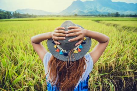 Asian women travel relax in the holiday. Stand natural touch mountain field. Thailand