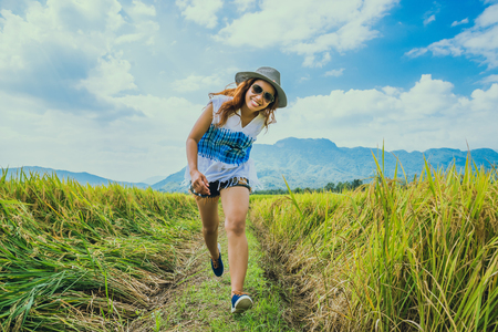 Asian women travel relax in the holiday. Stand natural touch mountain field. Women run happy smile Cheerful. Thailand Stock Photo - 91632041
