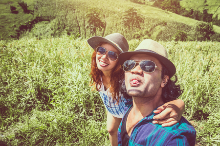 Lover women and men asians travel relax in the holiday. Stand natural touch mountain field. Selfie photograph couple. Thailand   Imagens