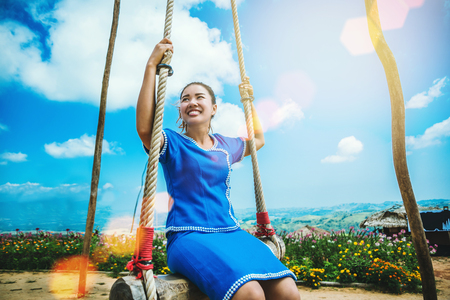 Asian women travel sleep relax.Women wear dresses. Living Swing. Thailand
