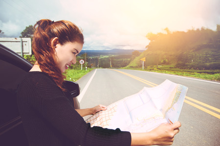 Female travelers travel nature mountain map navigation. Travel by car Stock Photo