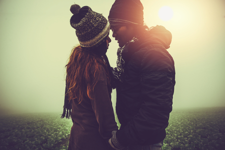 Lover women and men asians travel relax in the holiday. Stand hug get cold in the morning on the Mountain