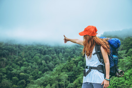 Asian women travel relax in the holiday. Standing on the mountain. Thailand 스톡 콘텐츠