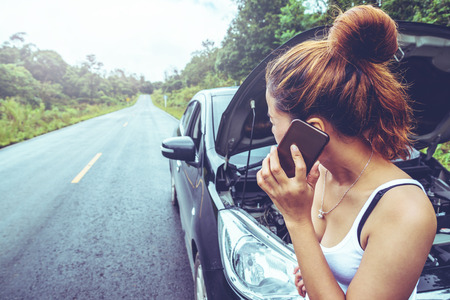 Asian women travel relax in the holiday. Broken car on the street. Thailand Stock fotó - 91536640