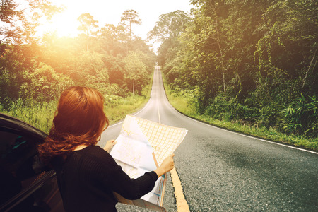 woman  travel. Female travelers travel nature mountain map navigation. Travel by car Stock Photo - 91716151