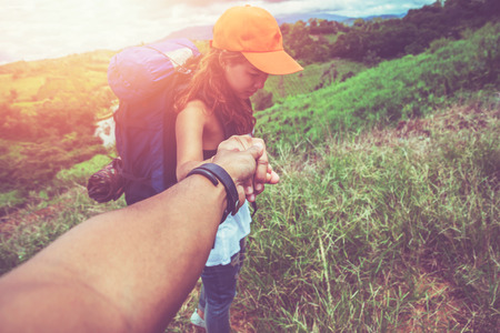 Male and woman couples asia. Walking hand travelers travel. Walking hand On the Moutain Stock Photo