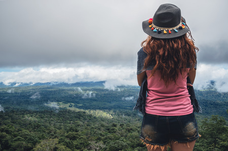 Asian women travel relax in the holiday. Standing on the mountain. Thailand Stock Photo