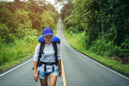 Asian women travel relax in the holiday. on the roadNatural route. Thailand Archivio Fotografico