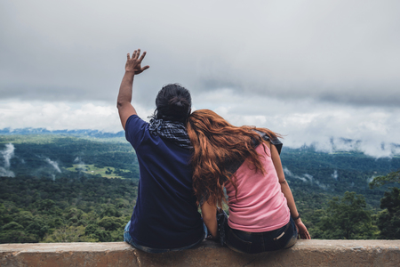 Lover women and men asians travel relax in the holiday. Take a scenic ride on the mountain. Thailand