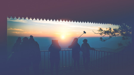 Wallpaper background Tourists photograph the sunrise in the morning on the mountain.. phurue thailand Tropical forests