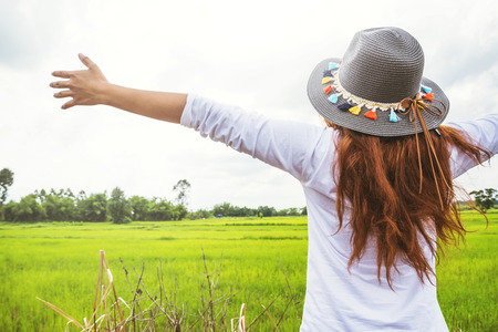 Asian women travel relax in the holiday. on a green pasture. Imagens - 91536006