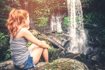 woman asia travelers travel. Walking hand travelers travel nature Forests, mountains, waterfalls. puhinrongkla  romklao-paradorn waterfall