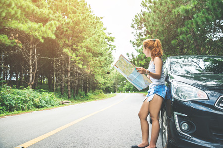 woman  travel. Female travelers travel nature mountain map navigation. Travel by car Stock Photo - 91676972