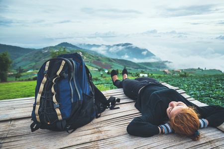 Asian women travel sleep relax. Morning atmosphere nature Forests, mountains. Phu Thap Buek Thailand