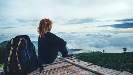 Asian women travel relax. Morning atmosphere nature Forests, mountains. Phu Thap Buek Thailand Stock Photo